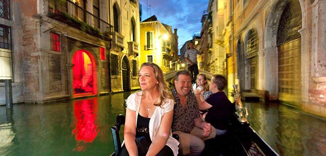 Twilight gondola ride, Venice, Italy