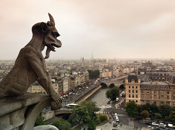 Gargoyle and view out from Notre-Dame Cathedral, Paris, France