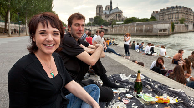 Riverbank picnic near Notre-Dame Cathedral, Paris, France