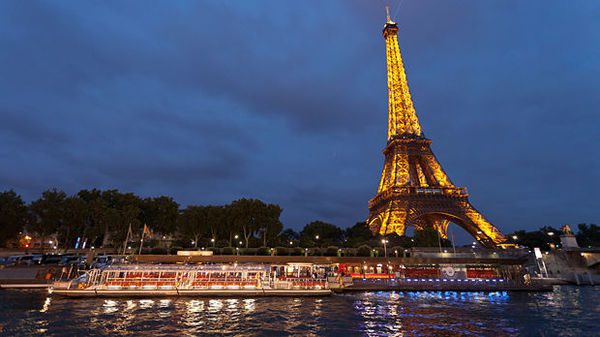 Eiffel Tower and riverboats, Paris, France