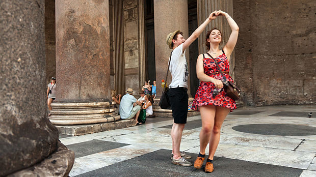 Dancing in the portico of the Pantheon, Rome, Italy