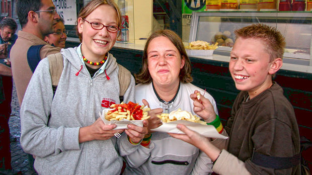 Kids with frites, Bruges, Belgium