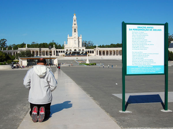 Pilgrim outside Basilica of Our Lady of Fátima, Portugal