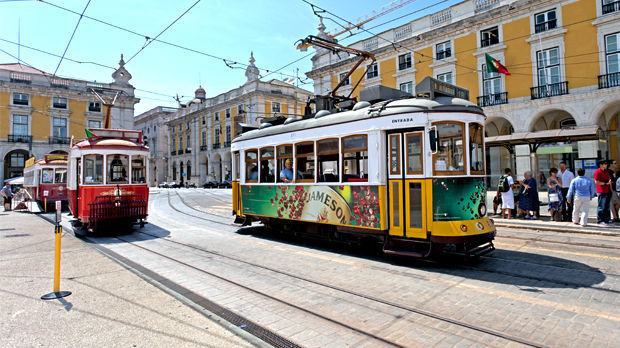 Trolleys on Praça do Comercio, Lisbon, Portugal