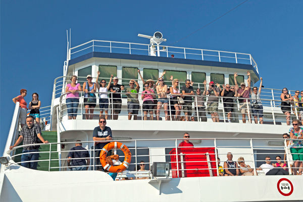 Ferry passengers just off the Croatian coast