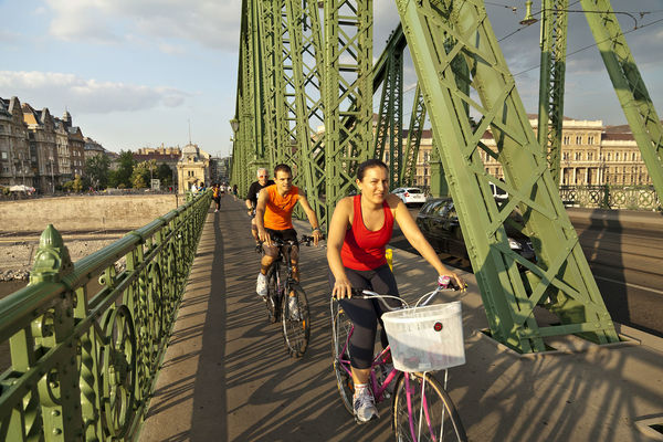 Biking over Liberty Bridge, Budapest, Hungary