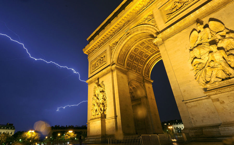 Arc de Triomphe in thunderstorm, Paris, France