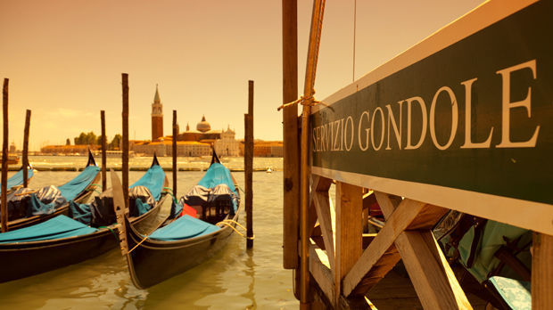 Gondola stand with Church of San Giorgio Maggiore in background, Venice, Italy