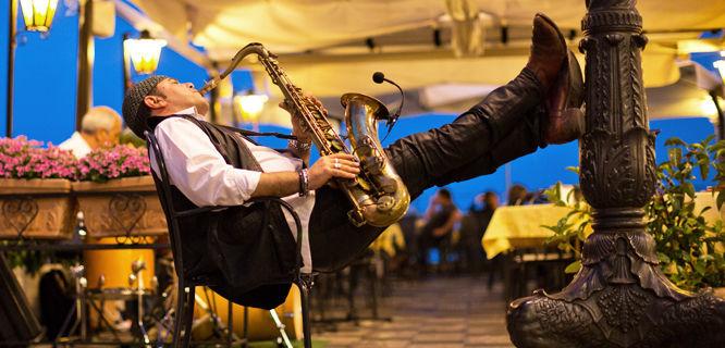 Restaurant musician on Piazza IX Aprile, Taormina, Sicily, Italy