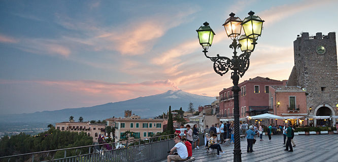 Taormina and Mt. Etna at dusk, Sicily, Italy