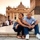 A couple sits outside St. Peters in Vatican City
