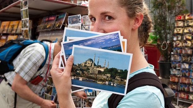 Postcard shopping, Istanbul, Turkey