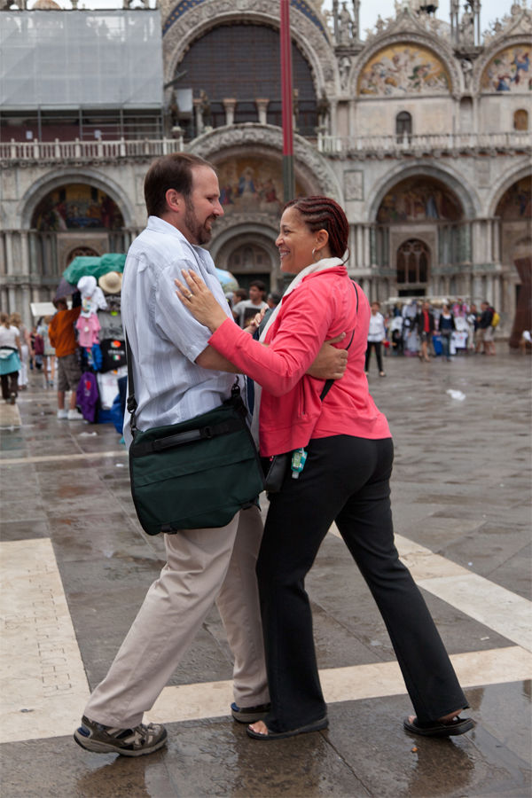 Dancing couple on St. Mark's Square, Venice, Italy