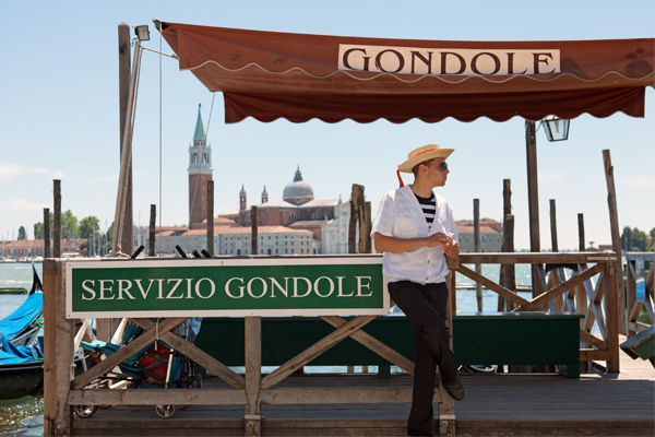 Gondola stand and gondolier, Venice, Italy