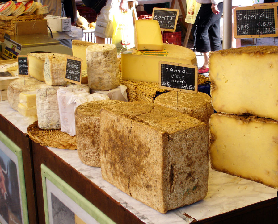 Cheese stand in market, Dordogne, France