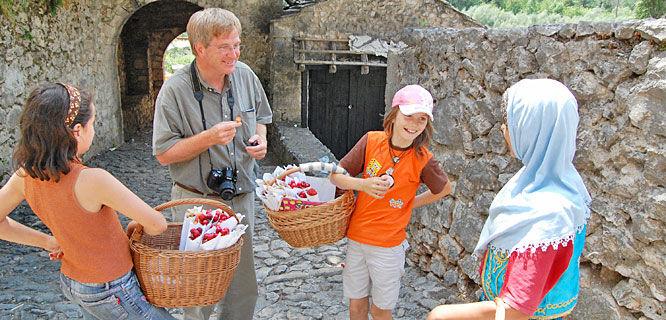 Rick and local girls in Pocitelj, Bosnia-Herzegovina