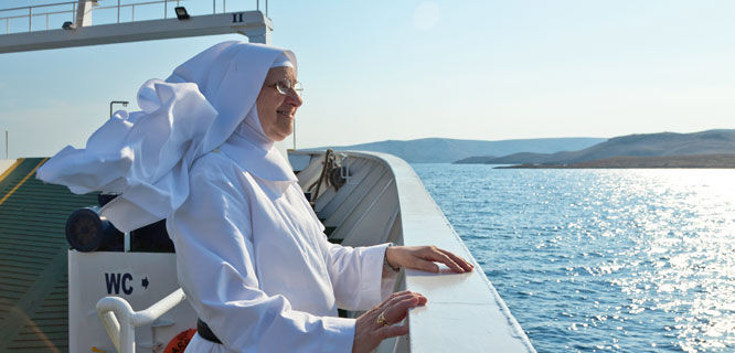 Nun on a coastal ferry, Croatia