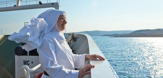 Nun on a coastal ferry, Croatia
