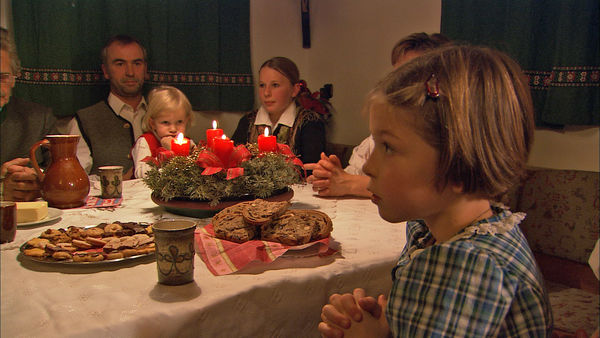 Cookies and prayer on Christmas Eve in Austria
