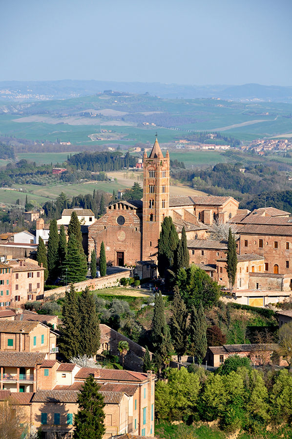 Basilica Santa Maria dei Servi and Tuscan countryside as seen from Duomo Museum, Siena, Italy