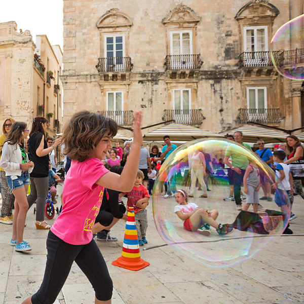 Piazza playtime, Syracuse, Sicily, Italy