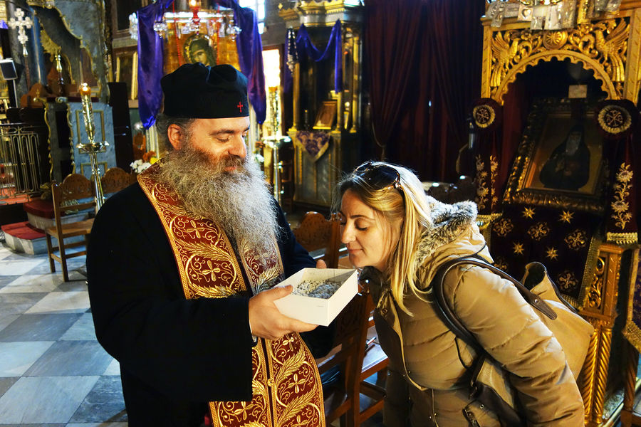 Inhaling incense, Nafplio, Greece