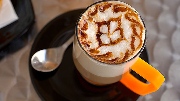 A cappucino with decorated foam