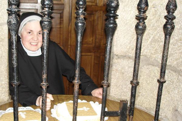 Nun selling convent-produced almond cakes, Santiago de Compostela, Spain