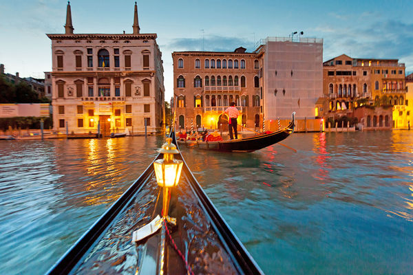 Twilight gondola ride, Venice, Italy