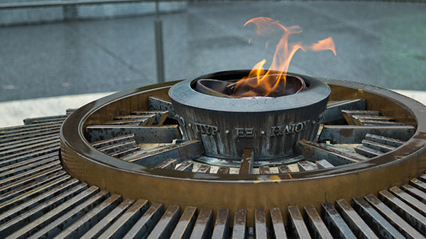 The Olympic flame flickers between editions of the games at the Olympic Museum and Park, Lausanne, Switzerland