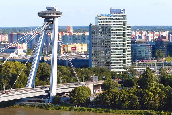 "SNP Bridge and its ""UFO"" observation deck (with Petržalka suburb in background), Bratislava, Slovakia"