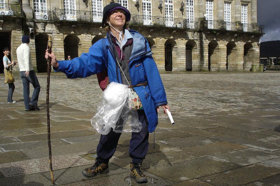 Camino pilgrim arriving in Santiago de Compostela, Spain