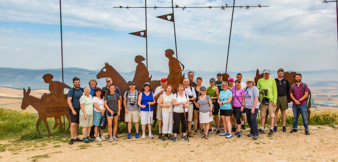 Tour members gather for a group photo on the Camino de Santiago, Spain