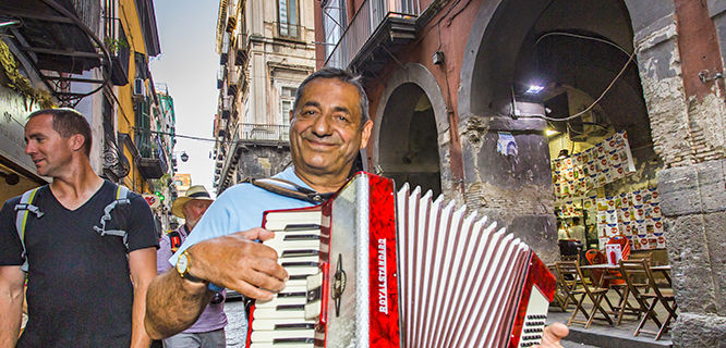 A man playing the accordion in Naples, Italy