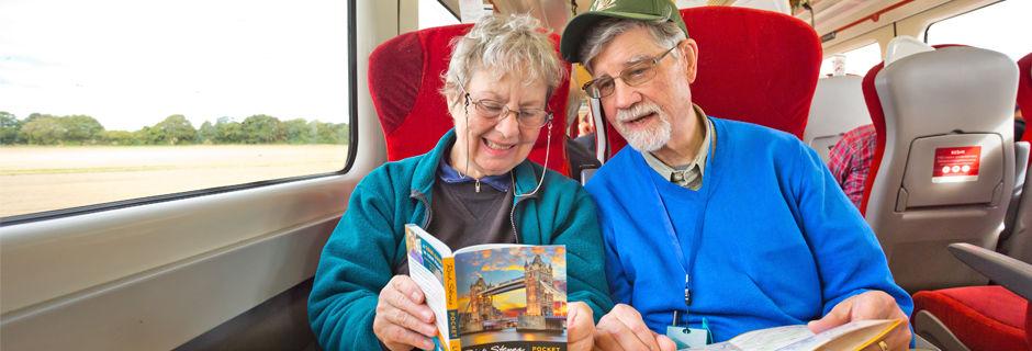 Couple reading Pocket London guidebook
