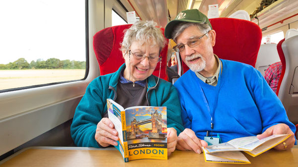 Couple reading Pocket London guidebook
