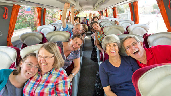 Happy riders on a tour bus, France