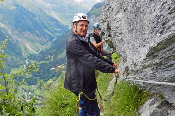 Rick on a cliff in Gimmelwald, Switzerland