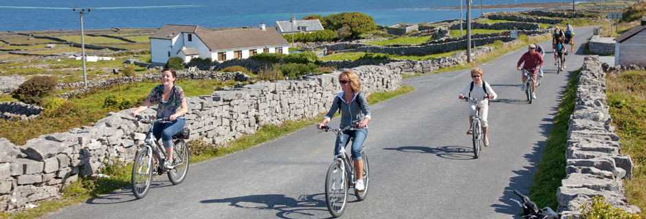 A group of cyclists in the Aran Islands, Ireland