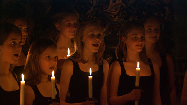 A candle-lit group of choirgirls