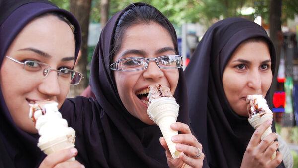 Girls eating ice cream, Iran
