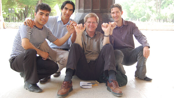 Rick and friends hooking fingers, Iran