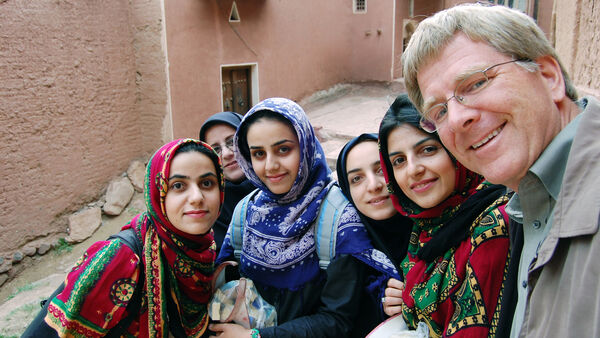 Rick taking a selfie with colorfully dressed girls, Iran