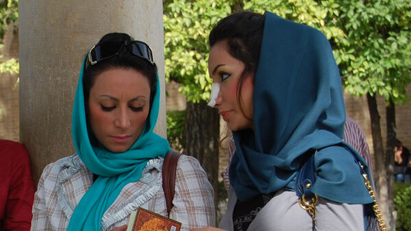 Lady with gauze on her nose, Iran
