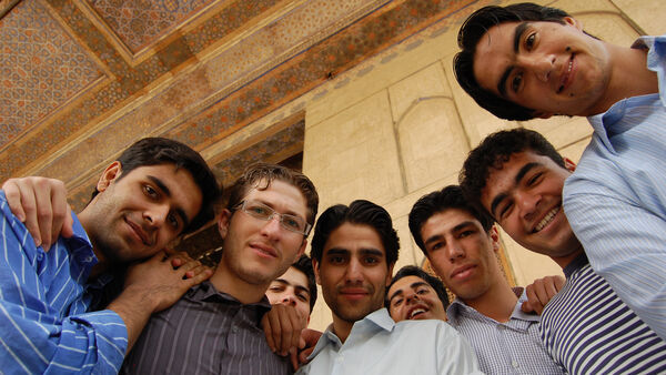 Locals gathered around the camera, Iran