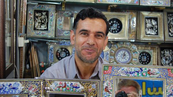 A smiling shopkeeper, Iran