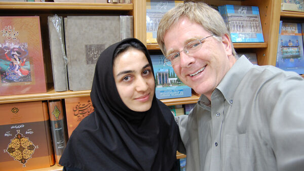 Rick and a woman in a bookstore, Iran