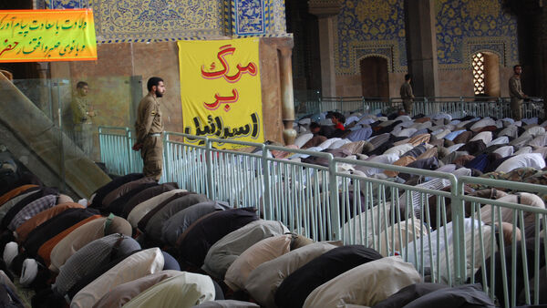 Crowds bowing in prayer, Iran