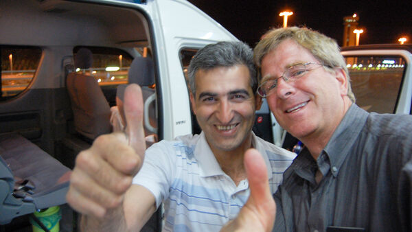 Rick and his driver celebrating with a thumbs up, Iran