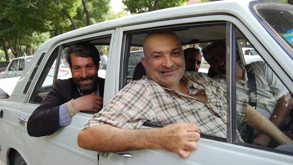 Cheerful passengers in a car, Iran